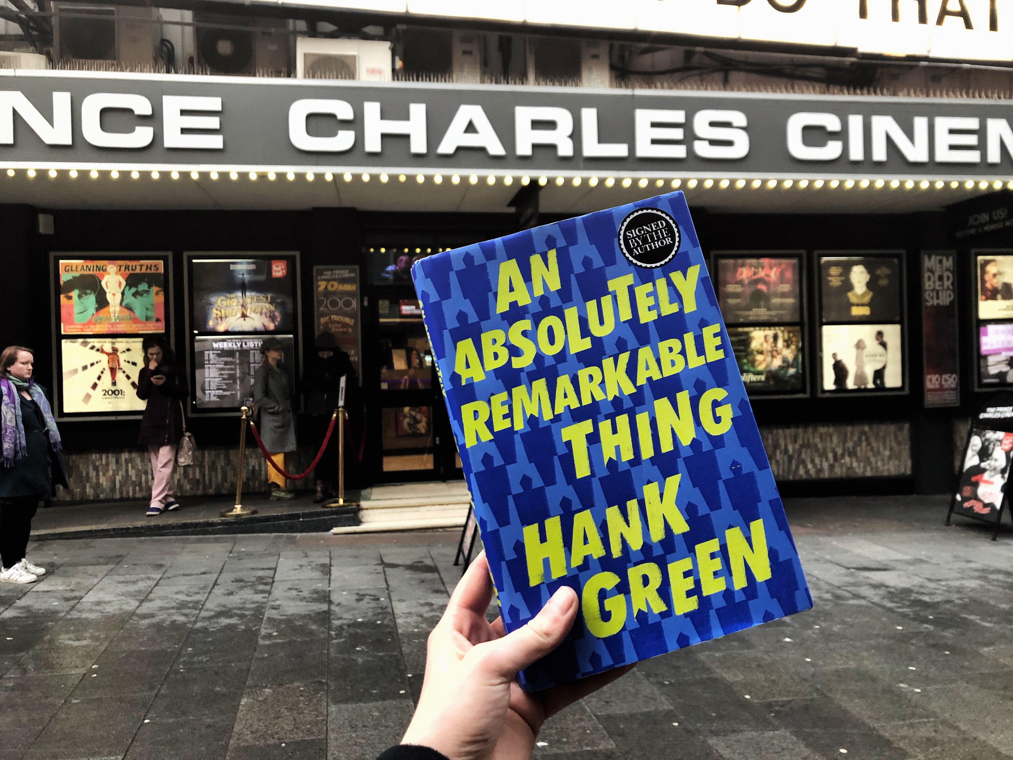 An Absolutely Remarkable Thing held up in front of The Prince Charles Cinema, where the event was held.