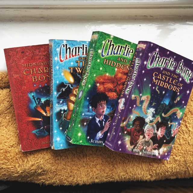 Selection of colourful Charlie Bone books.