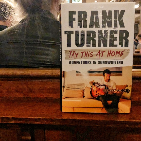 Frank Turner's new book Try This At Home stood upright on a pew, as the event was held in a church.
